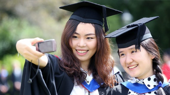 Two female graduands taking a selfie