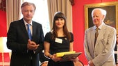 Chloe Samuels (centre) is presented with her German Teacher Award by German Ambassador Dr Peter Ammon (left) and renowned writer John le Carré (right).