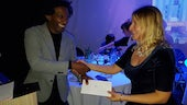 Poet Claire Williamson receives her prize from judge Lemm Sissay
