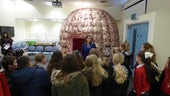 Dr Emma Kidd introducing school children to the Brain Games Dome