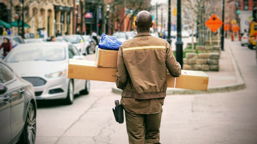 Man carrying parcels on street