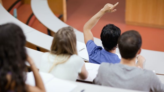Student raising his hand in class