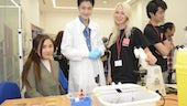 Photo of sixth formers at interactive demo at STEM conference