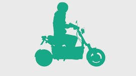 person on scooter green icon