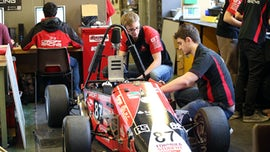 Students working on Formula Student racing car