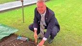 VC planting rainbow flag