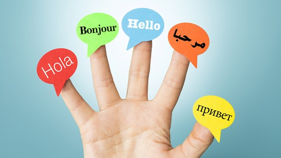An open hand with hello spelled in five different languages