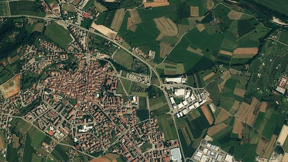 An aerial view of fields and houses