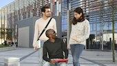 Group of three international postgraduate students, talking