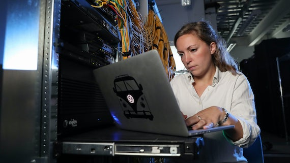Woman working on laptop at Airbus