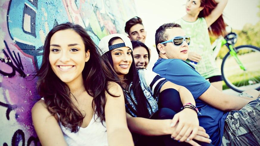 teenagers infront of graffiti wall