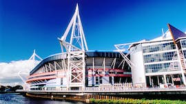 Principality Stadium against a bright blue sky.