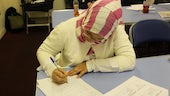 Female student in head scarf studying