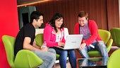 Students around a laptop
