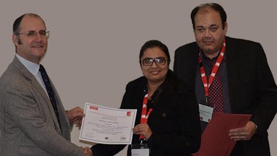 Rabia Abid receiving her prize