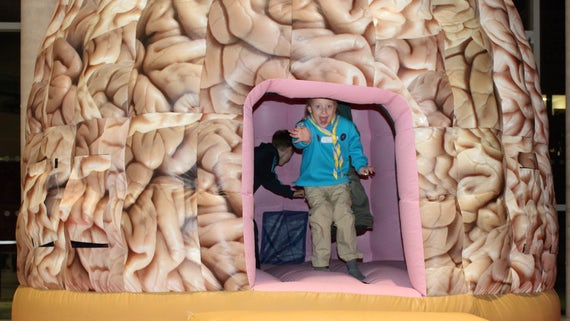 Photograph of child in giant brain dome