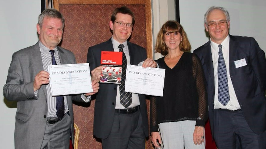 Image of Dr Robert Mason and Barry Evans receive their prize