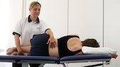 Physiotherapy student learning to apply techniques to a patient.