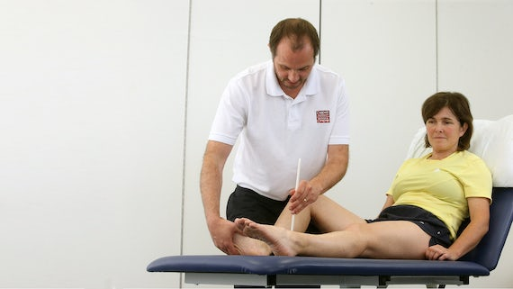 Physiotherapy student practising their skills on another student.