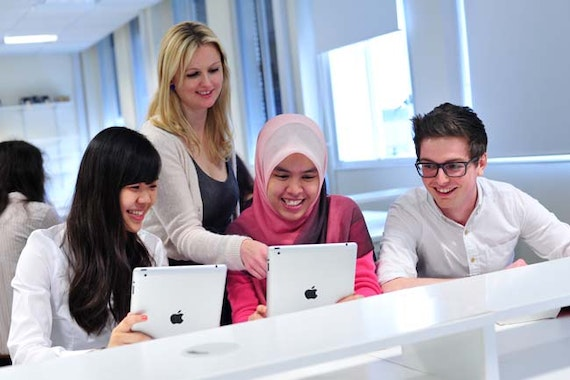 Students studying in the Redwood Building.