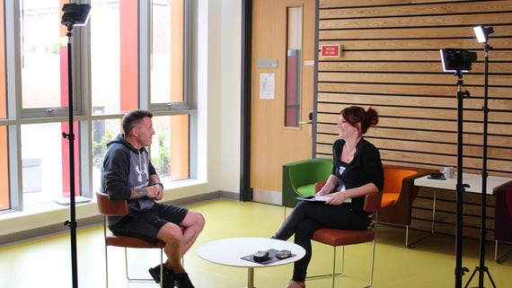 Photograph of Neilson and Hannah being interviewed
