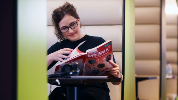 Woman wearing glasses looking at a brochure