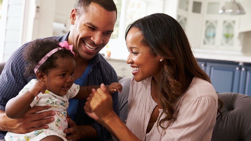 Mother and father with baby girl