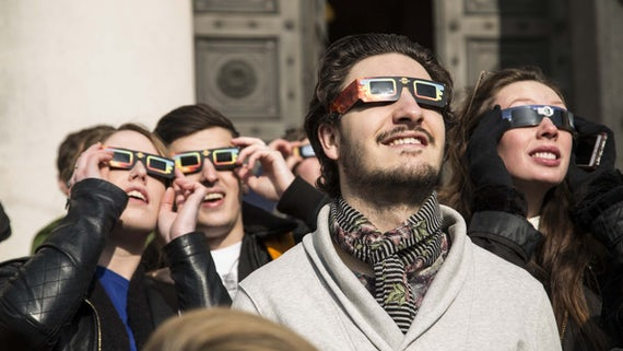 People stood outside the National Museum of Wales viewing the partial solar eclipse