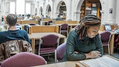 Two students studying back to back in the Science Library