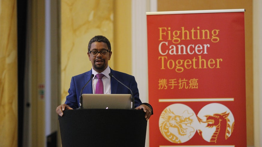Photograph of Vaughn Gething speaking at the surgical conference