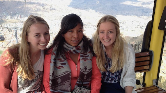 Essay winner Anna (right) with her sister Katie with Doris during their visit to Bolivia.