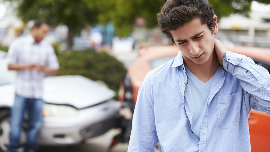 Image of a teenager suffering from whiplash following a car accident