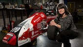 Karen Holford with formula 1 car