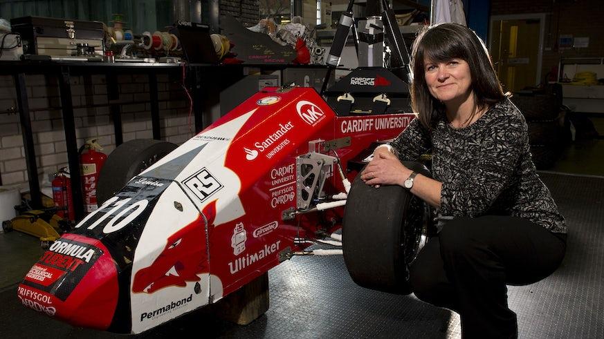 Karen Holford with formula 1 car