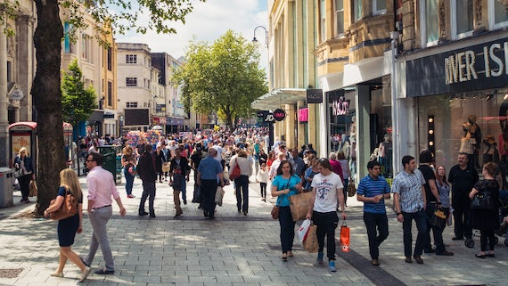 Image of a busy high street filled with shoppers