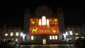Cardiff University Main Building lit up with a Chinese New Year greeting