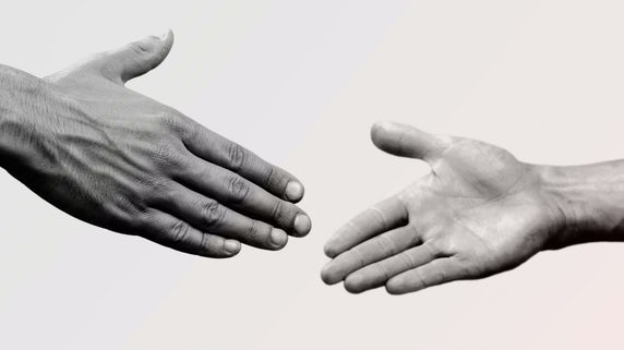Image of partners shaking hands