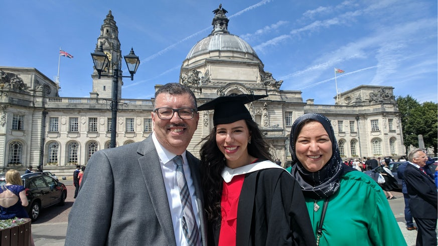 Graduate with her parents