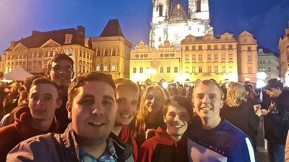 Dr Dan Bickerton and students in Prague