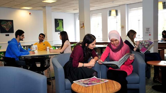 Students enjoying the social space in the Redwood Building