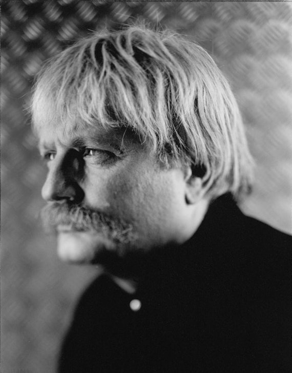 Black and white photo of a person with grey hair looking away from the camera