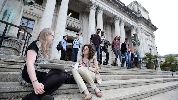 Postgraduate students sitting on the steps