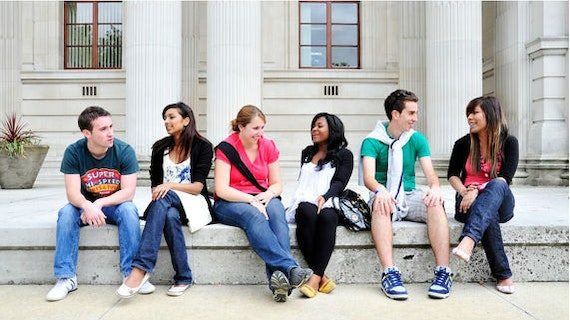 students relaxing outside Glamorgan building.