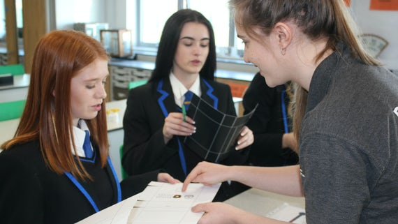 Students taking part in physics lesson