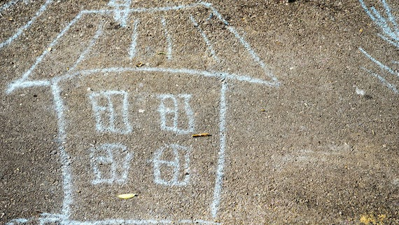 House drawn in chalk on ground