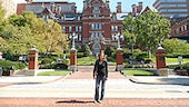 Woman standing in front of John Hopkins University's main building.