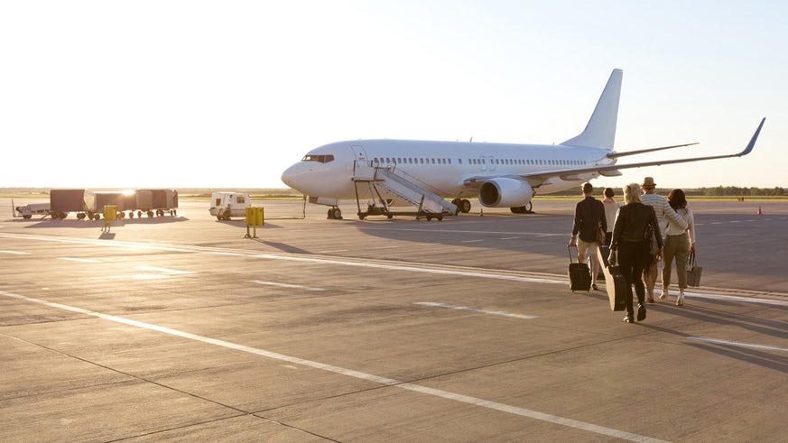 People walking towards plane