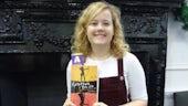 Efa Mared Edwards holds the Welsh translation of Longbow Girl