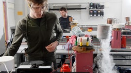 A student works in the Physics lab on a project