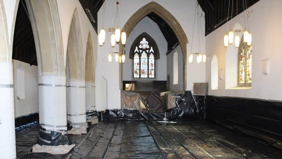 installation of polythene damp proof membrane during retrofit of church